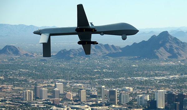 predator_drone_in_flight_over_city